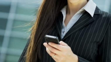 Businesswoman with mobile phone — Stock Video