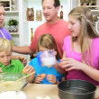 Parents and children making cake — Stock Video #50339741