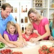 Parents helping children prepare food — Stock Video #50339891