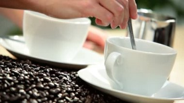 Female Hands Stirring Cups Fresh Brewed Coffee — Stock Video