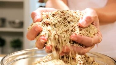 Dry grains running through hands — Stock Video