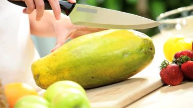 Fresh Tropical Papaya Fruit Being Sliced Hands Only — Stock Video