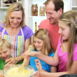 Parents and children making cake — Stock Video #50340295