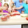 Family preparing pizza in the kitchen — Stock Video #50340341