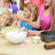 Parents and children making cake — Stock Video #50340369