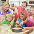 Parents and children making cake — Stock Video #50340377