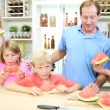 Parents and children sharing watermelon — Stock Video #50340385