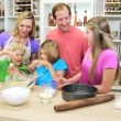 Parents and children making cake — Stock Video #50340449