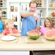 Father slicing watermelon for family — Stock Video
