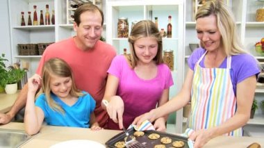 Family at kitchen making cookies — Stock Video