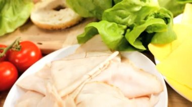 Fresh Bagel Filled Healthy Salad Ingredients Close Up — Stockvideo