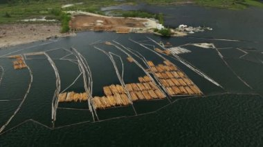 Aerial view Harrison Lake log boom barrier to collect river logs, Rockies, Canada — Stock Video