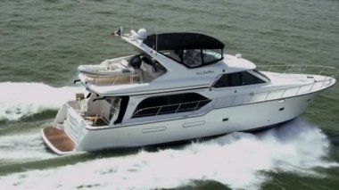 Aerial view luxury motor cruiser at speed — Stockvideo