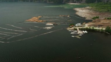 Aerial view Harrison Lake log boom barrier to collect river logs, Rockies, Canada — Stockvideo
