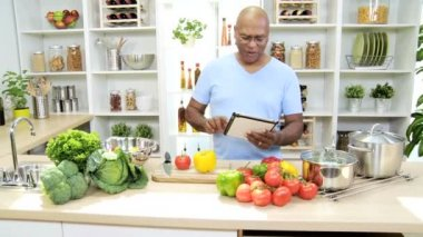 Man in the kitchen preparing with tablet — Stock Video