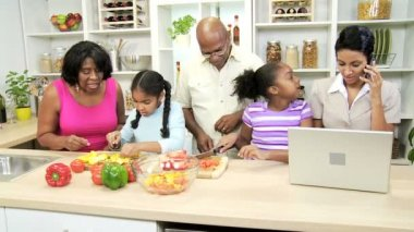 Family cook in the kitchen when a businesswoman talking on mobile phone — Stock Video