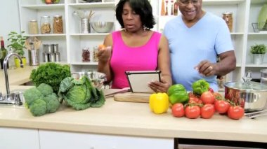 Couple in the kitchen preparing with tablet — Stock Video