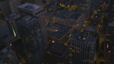 Aerial illuminated close up Skyscraper rooftop view Seattle, USA — Stockvideo