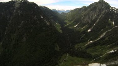 Aerial view remote mountain valley forest wilderness, Canada — Stock Video