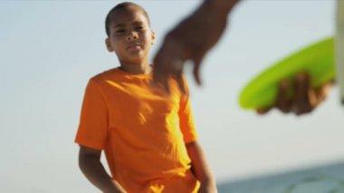Ethnic boy catching plastic disc — Vidéo