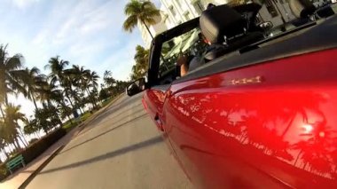 Red convertible on Ocean Drive — Stock Video