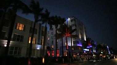 Night driving across illuminated restaurants — Stockvideo