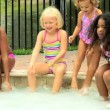 Friends playing in swimming pool — Stock Video #50942837