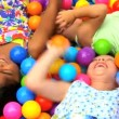 Little girls in ball pool — Vídeo Stock