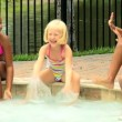 Friends playing in swimming pool — Stock Video #50943095