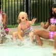 Friends playing in swimming pool — Vidéo