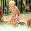 Friends playing in swimming pool — Stock Video #50943539