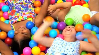 Little girls in ball pool — Stock Video