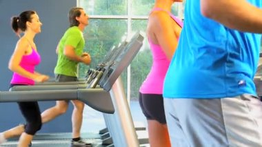 Multi ethnic gym members exercising — Stock Video