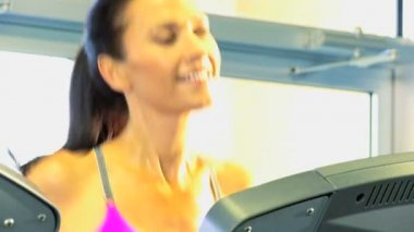 Female keeping fit on exercise equipment — Stock Video
