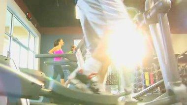 Gym members on modern equipment — Stock Video