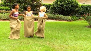 Little girls in home garden — Stock Video