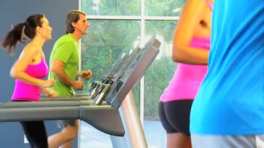 Multi ethnic gym members exercising — Video Stock