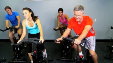 Gym members on exercise bikes — Stock Video