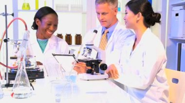 Medical assistants working with wireless tablet — Stock Video