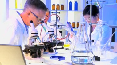 Medical Technicians using Laboratory Equipment — Stock Video