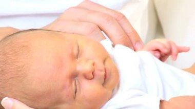 Newborn baby boy in the hands of parents — Stock Video