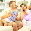 Parents playing with daughters on sofa — Stock Video #51651571