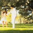 Young couple playing with baby in the park — Stock Video #51657339