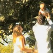 Young couple playing with baby in the park — Stock Video #51658215