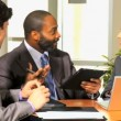 Business people with tablet discussing about company strategy — Stock Video #51659095