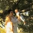 Young couple playing with baby in the park — Stock Video #51659137