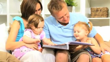 Young Parents Daughters with Photo Album — Stock Video