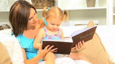 Young Mother Daughter with Photo Album — Stock Video