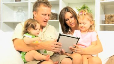 Couple with daughters using wireless tablet — Stock Video