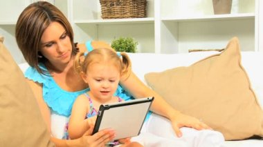 Pre School Girl Parent Using Wireless Tablet — Stock Video